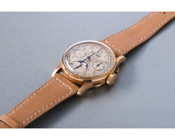 PATEK PHILIPPE An extremely rare and historically important pink gold perpetual calendar chronograph wristwatch with moon phases, reference 1518. Manufactured in 1948.