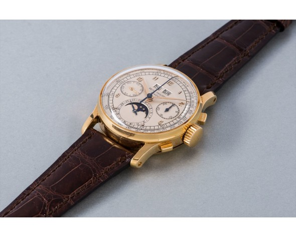 PATEK PHILIPPE An exceptional and very rare yellow gold perpetual calendar chronograph wristwatch with moon phases, reference 1518. Manufactured in 1951.