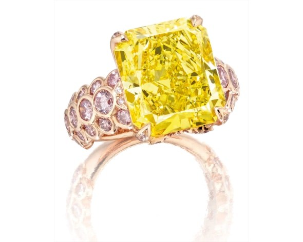 A Fine Fancy Vivid Yellow Diamond and Pink Diamond Ring