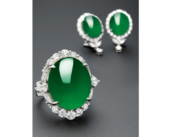 A Very Fine Jadeite Cabochon Ring and Pair of Matching Earrings