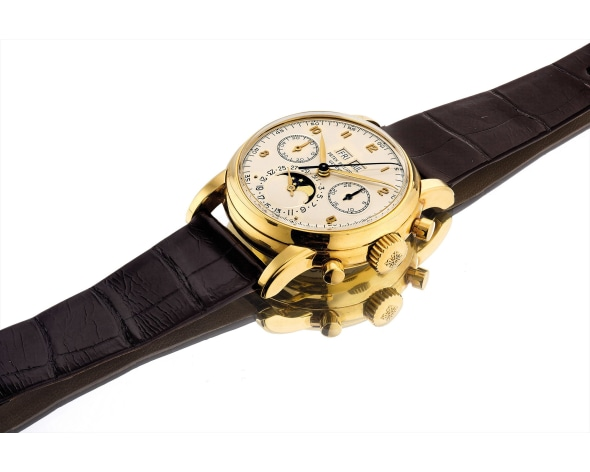 PATEK PHILIPPE An extremely fine and rare yellow gold perpetual calendar chronograph wristwatch with moon phases, 2.5 series reference 2499 , 1966