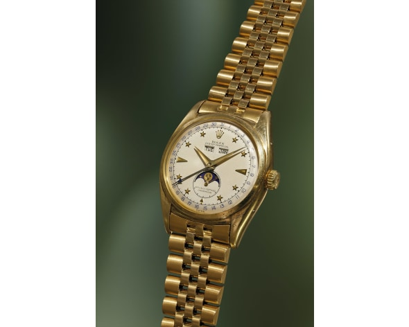 ROLEX An exceptionally fine, rare and important yellow gold triple calendar wristwatch with star-set numerals, moon phases and bracelet, reference 6062, circa 1952.