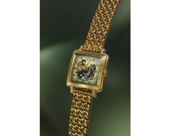ROLEX A highly rare, unique and exceptional yellow gold square wristwatch with cloisonné enamel dial depicting Neptune and heavy bracelet, reference 4645, circa 1953.