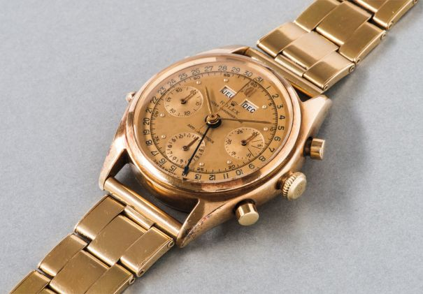 An extremely rare and highly attractive yellow gold triple calendar chronograph wristwatch with two-tone gold dial and bracelet