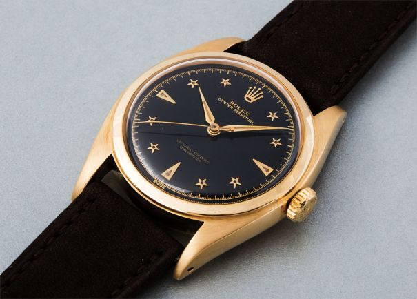 A very rare and most attractive yellow gold wristwatch with black dial and star-shaped indexes