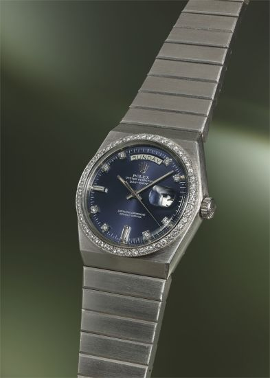 A very rare, important and heavy platinum and diamond-set tonneau-shaped calendar wristwatch with sweep center seconds, light blue dial and bracelet