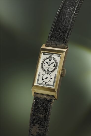 A rare 9k yellow gold rectangular wristwatch with three-tone silvered dial, rating certificate and fitted presentation box