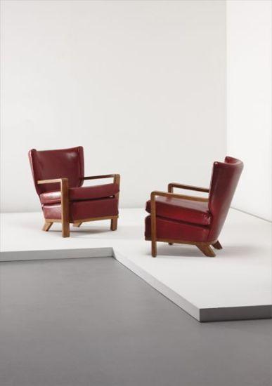 "Pair of ""Ecusson"" armchairs"