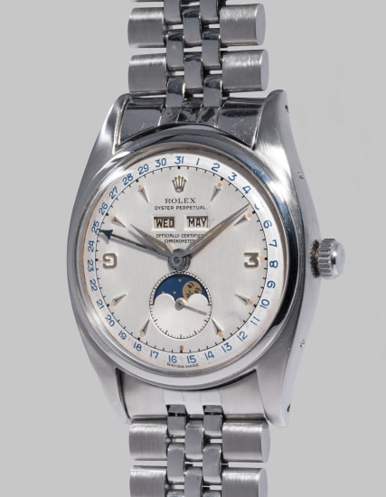 An incredibly rare and most attractive stainless steel triple calendar wristwatch with two-tone dial, moonphases and bracelet