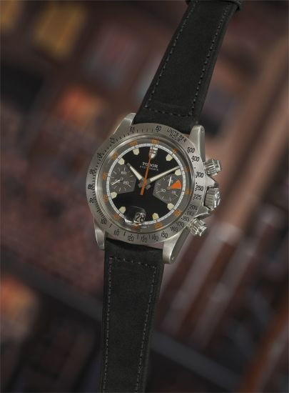 A very rare and attractive stainless steel chronograph wristwatch with matte black dial, tachymeter bezel, and date.