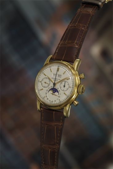 A very fine and rare yellow gold perpetual calendar chronograph wristwatch with moon phases.
