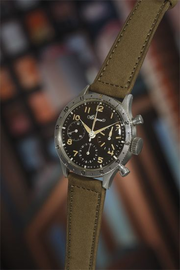 A very attractive and rare stainless steel flyback chronograph with tropical hands and numerals.