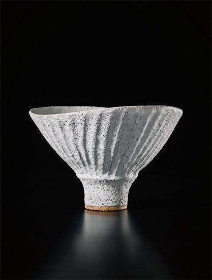 Oval bowl with fluted sides