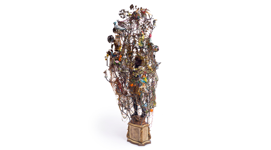 <b>Nick Cave</b> <i>Untitled</i>, 2015. Mixed media including cast-iron figure, ceramic birds, strung beads and metal flowers. © Nick Cave. Photo by James Prinz Photography. Courtesy of the artist and Jack Shainman Gallery, New York.