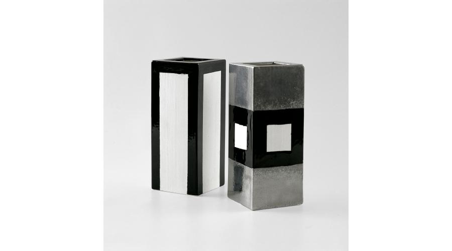 ETTORE SOTTSASS Cast vases, biscuit, mat platinum, gloss black. Galleria Il Sestante, Milan, 1962-1963