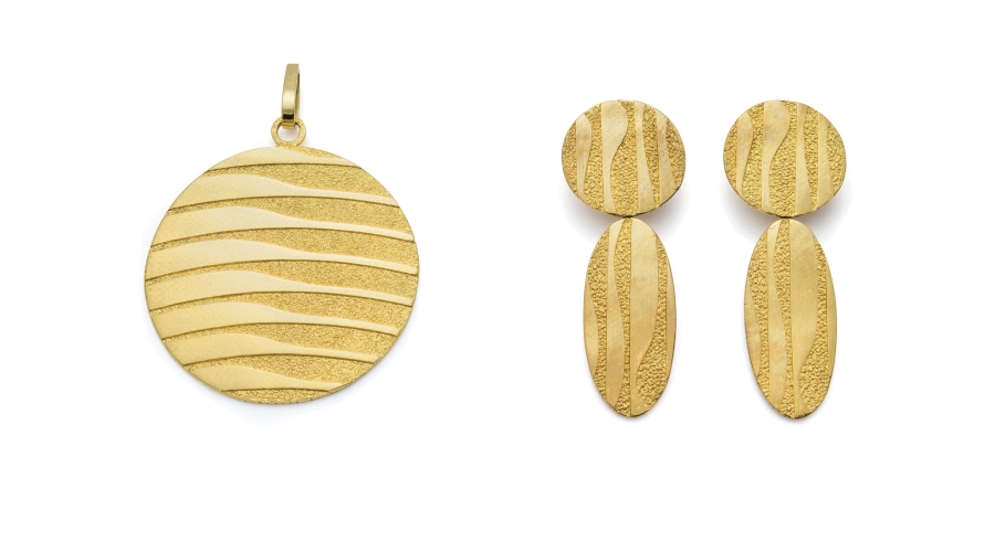 A Pair of Gold Earrings and Pendant, Georges L'Enfant. Sold for $27,500 (pre-auction estimate $5,000-7,000).