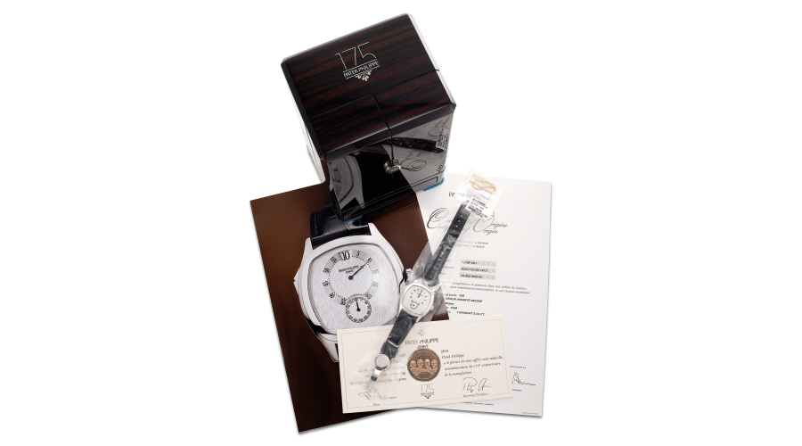 PATEK PHILIPPE, ref. 5275P-001. An exceptionally rare limited edition platinum chiming wristwatch with jump second and minute, digital jump hour, engraved dial and case, Certificate of Origin and presentation box, made for the 175th anniversary of Patek Philippe. Circa 2015