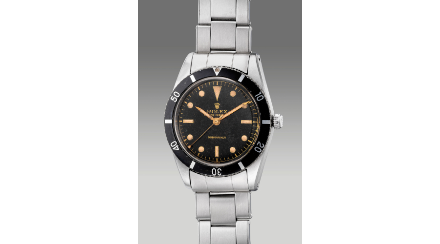 """ROLEX reference 6204, a very fine, early and well-preserved stainless steel diver's center secondswristwatch with """"gilt"""" dial and bracelet, circa 1954"""