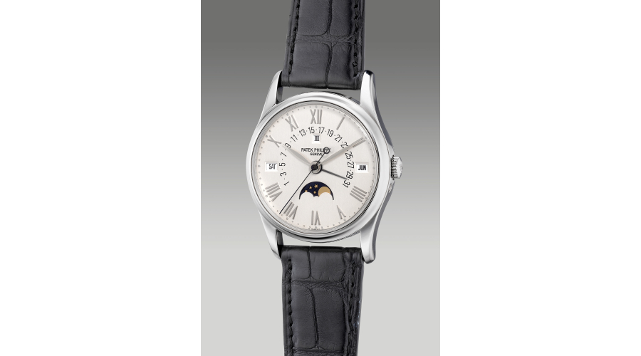 PATEK PHILIPPEreference 5050P, a fine and attractive platinum perpetual calendar wristwatch with moon phases, retrograde date, leap year indication, applied Roman numerals, Certificate of Origin and presentation box, circa 1995. Provenance: Reginald H. Fullerton, Jr