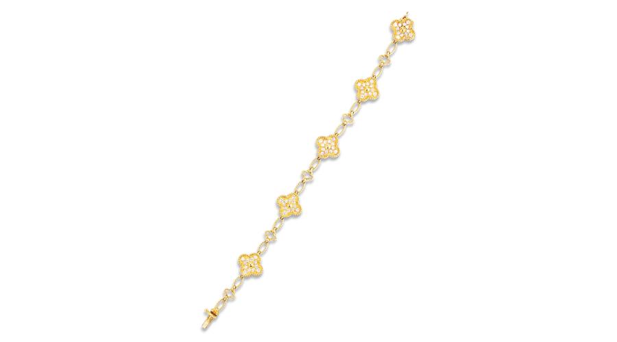 VAN CLEEF & ARPELS A Diamond 'Alhambra' Bracelet, Circa 1984