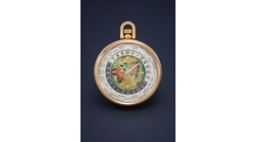A previously unknown and most probably unique pink gold open face worldtime Patek Philippe Ref. 605 HU with cloisonné enamel dial depicting a map of Europe, Asia, Africa