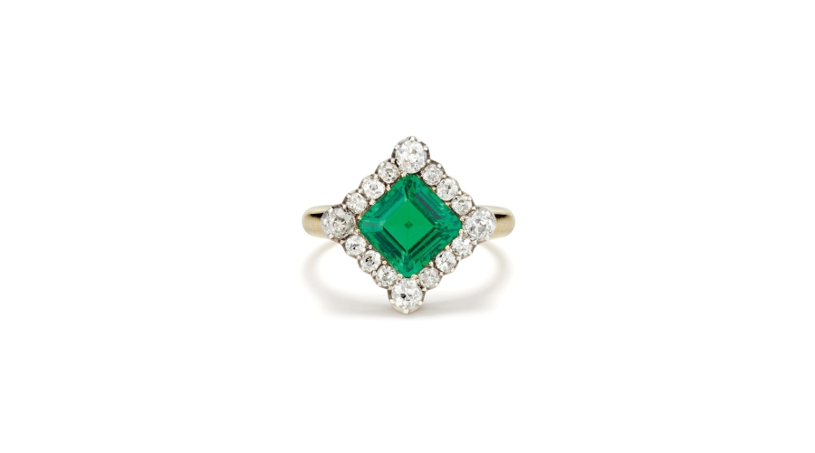 An Antique Emerald, Diamond, Gold and Silver Topped Gold Ring