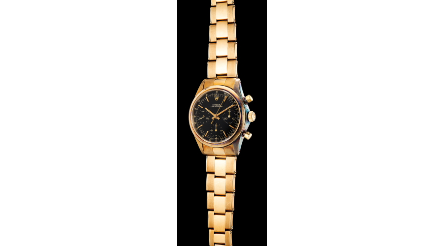 ROLEX, ref. 6238. An extremely rare and highly attractive 14k yellow gold chronograph wristwatch with black 'Glossy' dial and bracelet. Circa 1967