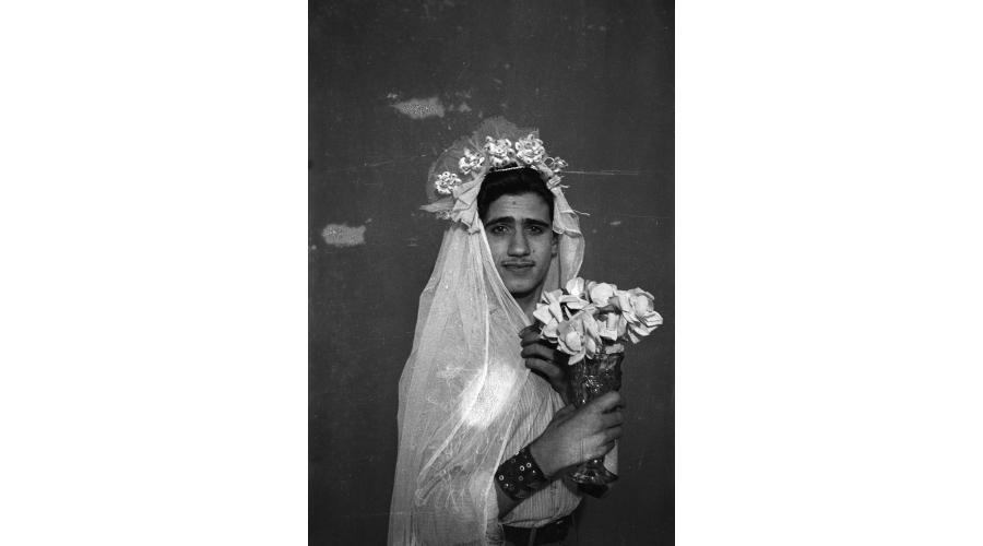 AKRAM ZAATARI Footnotes to Studio Practices; Najm posing with wedding dress, 2015