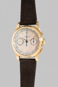 PATEK PHILIPPE Reference 530, circa 1949. The only known, large and very attractive yellow gold chronograph wristwatch with silver dial and Breguet numerals.