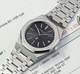 A very rare and attractive stainless steel wristwatch with date, bracelet and service papers