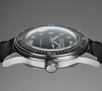 A rare and attractive stainless steel wristwatch with revolving bezel, made for the Polish Military