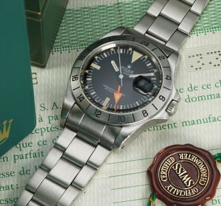 A rare stainless steel dual time wristwatch with centre seconds, date and bracelet
