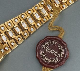 """An extremely rare and flamboyant yellow gold and diamond-set calendar wristwatch with centre seconds, diamond-set """"Octopussy"""" bracelet and wood dial"""