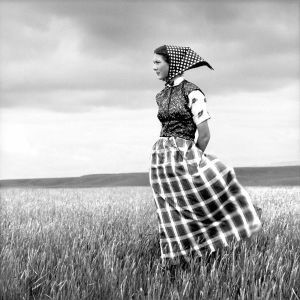 LAURA WILSON Emma, Hutterite Girl in Field, Duncan Ranch Colony Harlowton, Montana, June 17, 1994