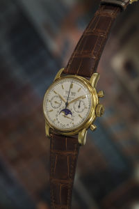 PATEK PHILIPPE Reference 2499 - 3rd Series. A very fine and rare yellow gold perpetual calendar chronograph wristwatch with moon phases, circa 1968. Sold for $459,000.