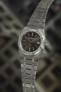 AUDEMARS PIGUET Royal Oak 'A-Series' - Reference 5402 ST. A very rare and highly attractive stainless steel wristwatch with date aperture, 'tropical' dial and integrated bracelet, circa 1972. Sold for $57,500.