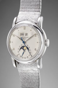 PATEK PHILIPPE An extremely rare, beautiful and historically important white gold perpetual calendar wristwatch with centre seconds and moonphases, reference 2497, manufactured in 1954.