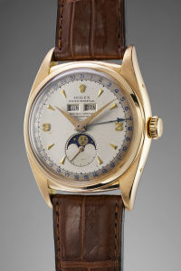 ROLEX An exceptionally fine, rare and important pink gold triple calendar wristwatch with moonphases and two-tone dial made in circa 1953. Reference 6062.