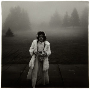 DIANE ARBUS A Flower Girl at a Wedding, Conn., 1964