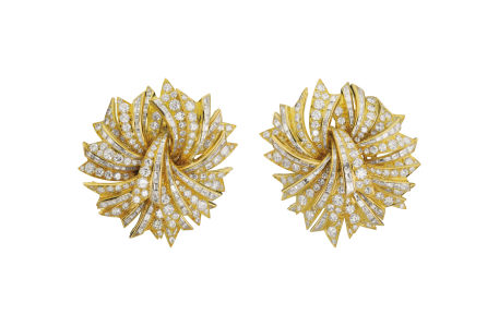 BULGARI Pair of yellow gold and diamond earrings. Sold for $43,750.