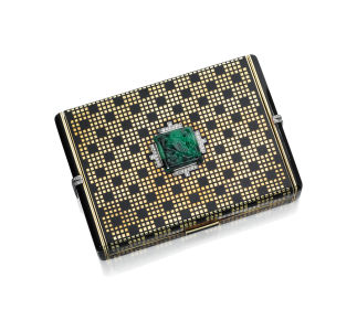 CARTIER Art deco gold, enamel and emerald box. Sold for $10,625.