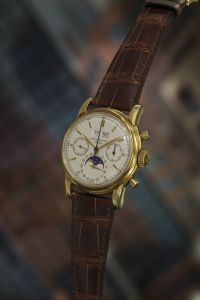 Patek PhilippeA very fine and rare yellow gold perpetual calendar chronograph wristwatch with moon phases.