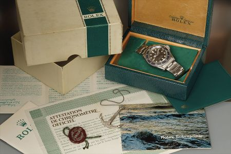 A highly attractive and rare stainless steel wristwatch with Mark II 'tropical' black dial, faded bezel, and bracelet, accompanied by inner and outer presentation boxes, guarantee, booklets, and hangtag.