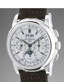 Patek Philippe - A very fine and extremely rare white gold perpetual calendar chronograph wristwatch with moonphases, Certificate and box, retailed by Tiffany & Co.