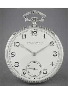 Patek Philippe - A fine and attractive chiselled and enameled platinum open face watch with art deco numerals