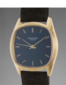 Patek Philippe - A fine and unusual yellow gold wristwatch with textured blue dial and winding crown on the back