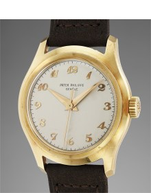 Patek Philippe - A very fine and rare yellow gold wristwatch with center seconds and Breguet numerals