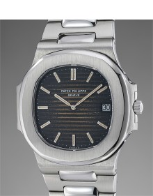 Patek Philippe - A very attractive and rare stainless steel wristwatch with date, tropical dial and bracelet
