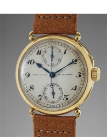 Patek Philippe - An extremely rare, well preserved and historically important yellow gold single pusher chronograph wristwatch with vertical registers and officer case