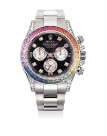Rolex - An extremely rare and attractive white gold, diamond and rainbow-colored-gem-set chronograph wristwatch with bracelet, original guarantee and box